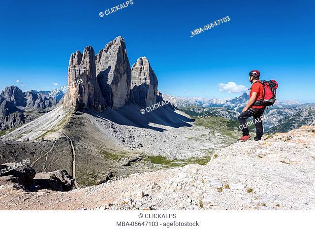 Sesto/Sexten, Dolomites, South Tyrol, province of Bolzano, Italy. Climber admires the Tre Cime di Lavaredo/Drei Zinnen