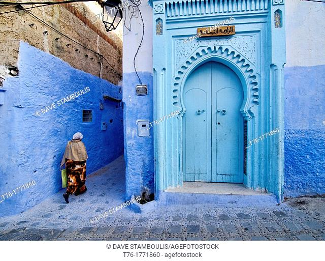 the colorful and atmospheric blue doors of Chefchaouen, Morocco