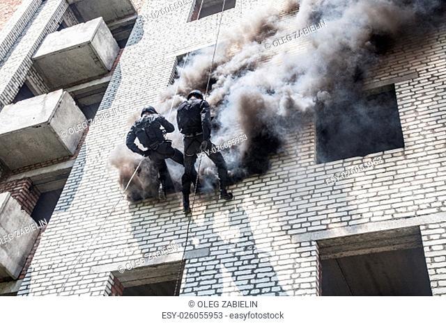 Spec ops police officer SWAT during assault operation