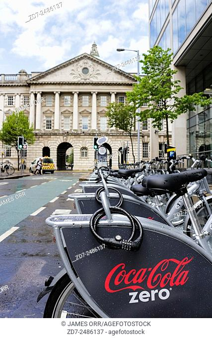Belfast Bikes at Linenhall Street, Belfast. Belfast City Hall is in the background Shooting date 11.05.15