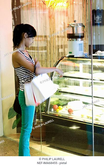 A young woman in a shopping mall Manila the Philippines