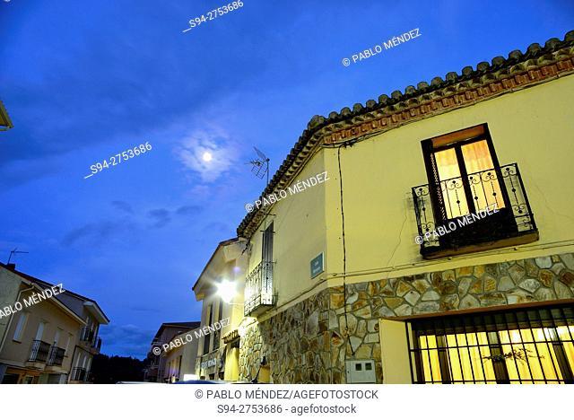 House and moon in Buitrago del Lozoya, Madrid, Spain