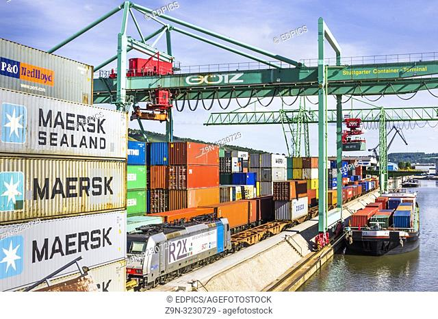 container terminal, containers are being loaded onto a freight train and a container barge , inland harbor, stuttgart, baden-wuerttemberg, germany