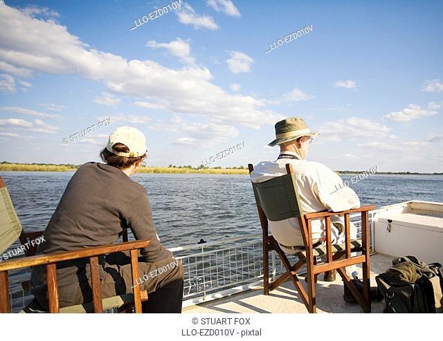 Mature Couple on a Boat on the Zambezi River  Southern Province, Zambia