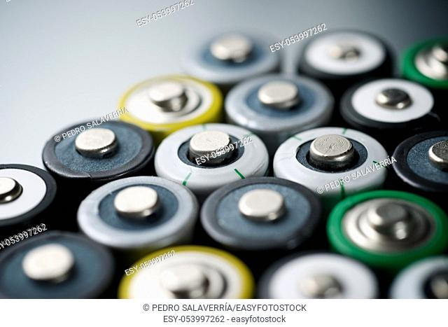 Many batteries on a metal table