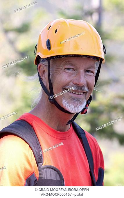 A man on a zip line tour in Whitefish, Montana