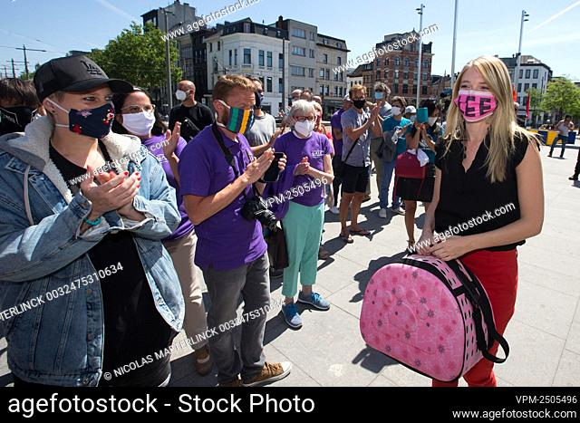 Selena Ali carrying an empty cat travel bag is greeted by supporters, after a session of the Antwerp court of First Instance