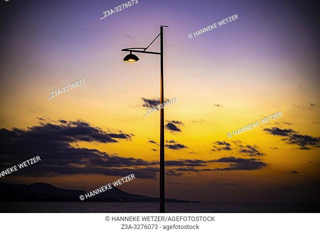Sunset with lamp post at the coastline of Las Palmas de Gran Canaria, Canary Islands