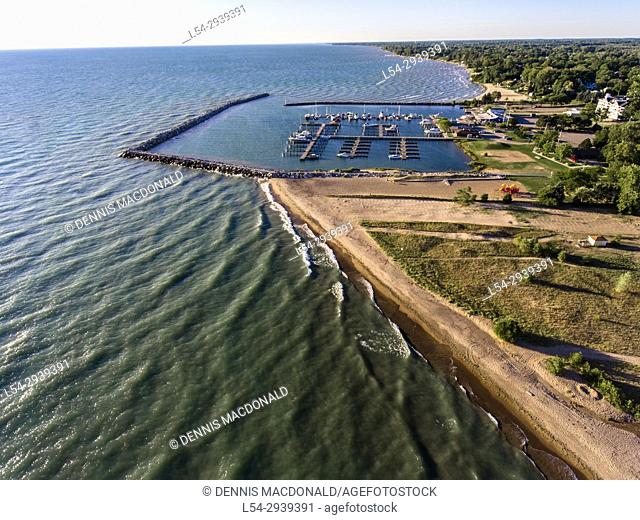 Aerial view of Lexington Michigan on Lake Huron showing a man made harbor and how it protects a marina from wind and waves