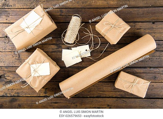 Gifts for Christmas packaged and wrapped on a wooden table
