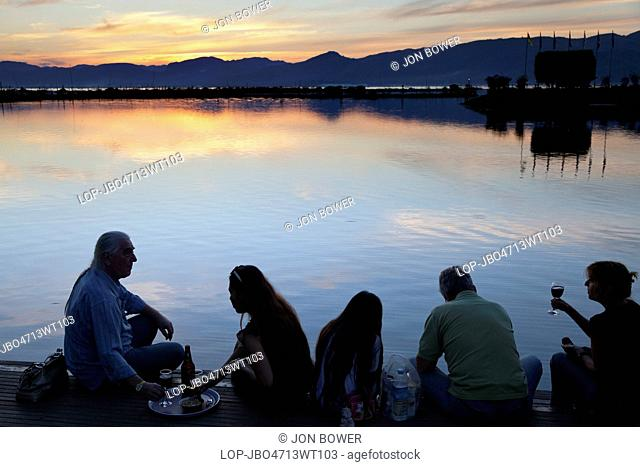 Myanmar, Shan, Lake Inle. A nice drink and snack at sunset on the Lake Inle Resort in Myanmar