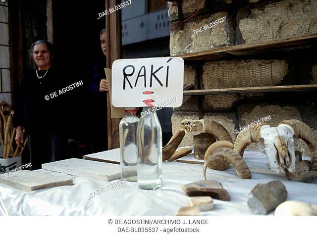 Raki for sale, anise and mint flavoured brandy, Axos, Crete, Greece