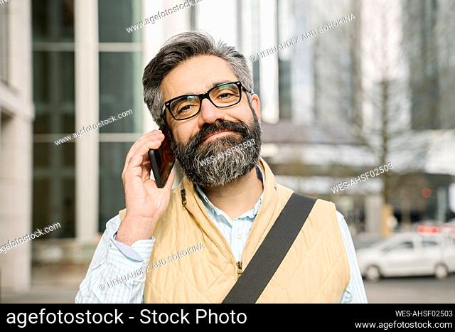 Portrait of man on the phone in the city, Frankfurt, Germany