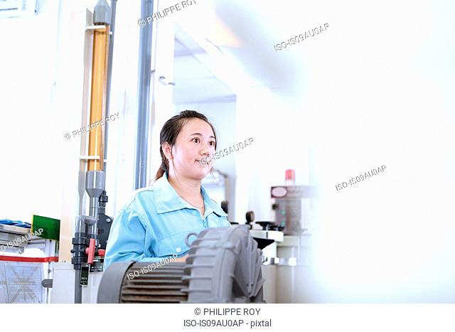 Young woman at work in flexible electronics plant