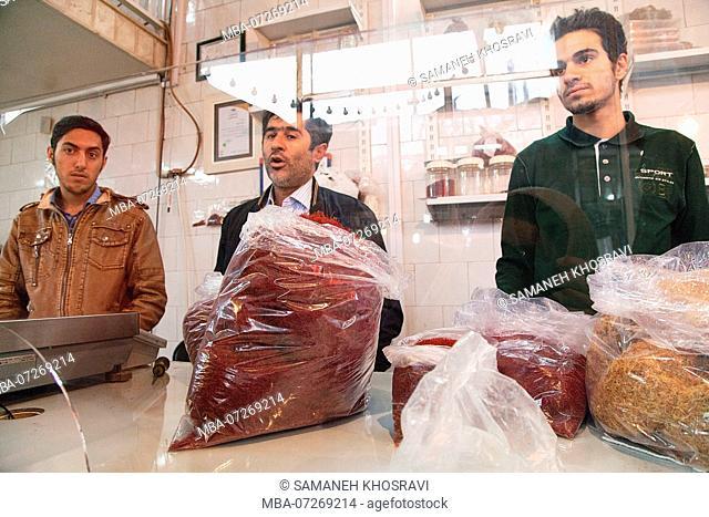 A saffron wholesaler in Torbat preparing the goods for international shipping