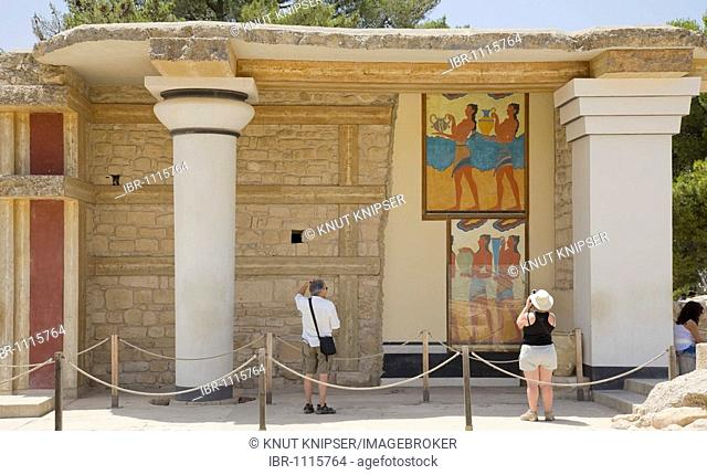 Tourists visiting and taking pictures of the Southern Propylaea on the grounds of the Minoan excavation of Knossos, Heraklion, island of Crete, Greece, Europe