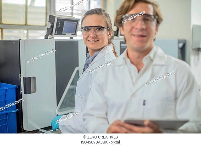 Portrait of two lab workers in thread factory