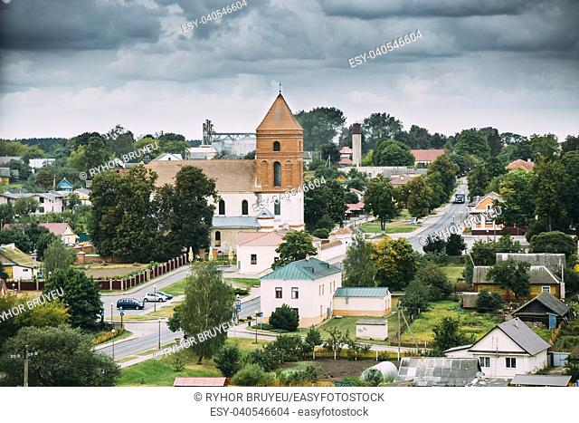 Mir, Belarus. Landscape Of Village Houses And Saint Nicolas Roman Catholic Church In Mir, Belarus. Famous Landmark