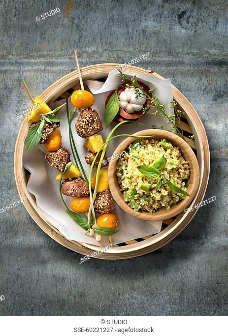 Sesame seed duck,mango and kumquat brochettes,green tomato tabbouleh