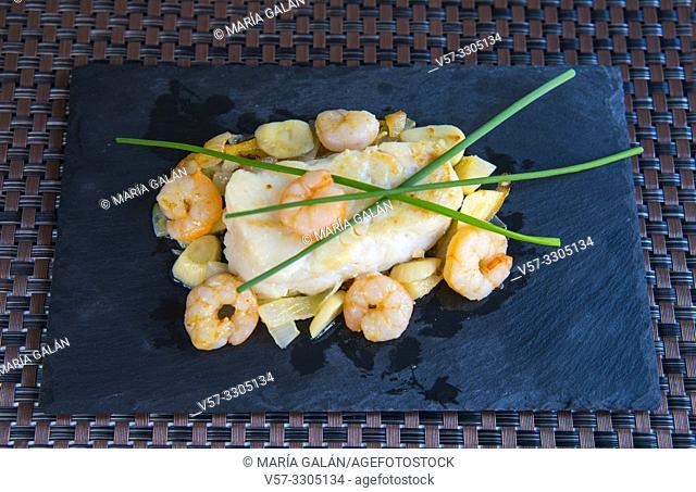 Hake loin with prawns, garlic and spring onion