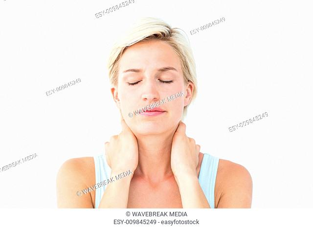 Woman with eyes closed suffering from neck ache