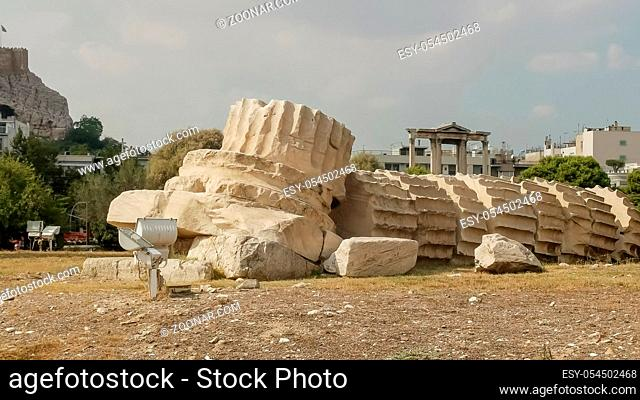 a fallen column at the temple of zeus ruins in athens, greece
