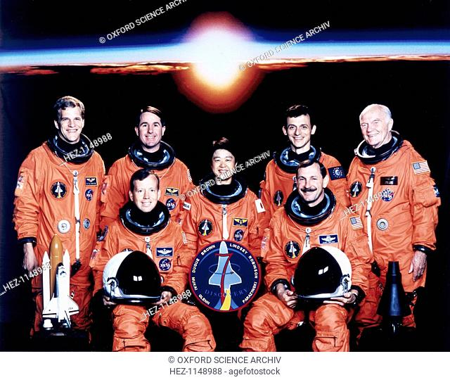 John Glenn and crew, June 1998. Seated are Curtis L Brown and Steven W Lindsey. Standing, from the left are Scott F Parazynski and Steven K Robinson