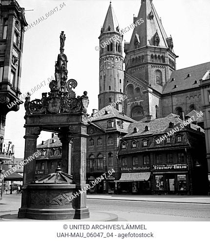 Der Hohe Dom zu Mainz mit Marktplatz, Marktbrunnen und Geschäften am Dom, Deutschland 1930er Jahre. Mainz cathedral with main market, fountain and shops