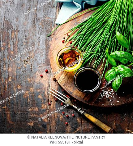 Herbs and spices on wooden board - cooking, healthy or vegetarian food concept