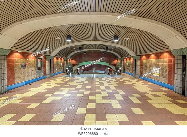 Curved roof and floor tiles of subway station
