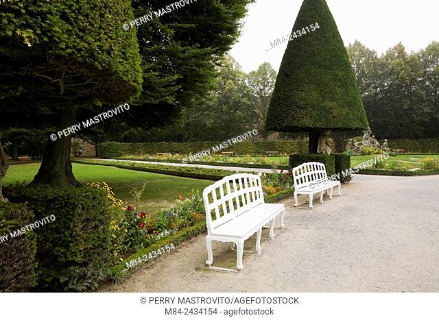 White benches at the Bishop's Residence Court gardens in late summer, Wurzburg, Germany