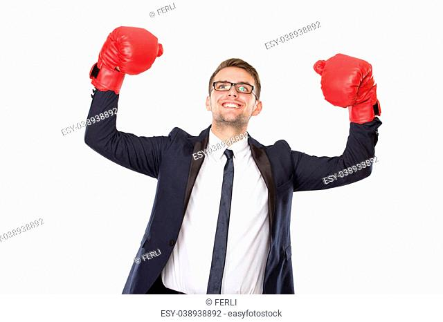 A portrait of a young businessman with boxing gloves