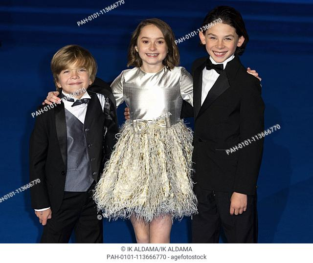 Joel Dawson, Pixie Davies and Nathanael Saleh attend MARY POPPINS RETUNS European Premiere at The Royal Albert Hall. London, UK