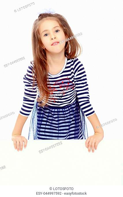 The little blonde girl with long hair and with a white bow on her head , in a blue striped summer dress.She peeks out from behind white banner