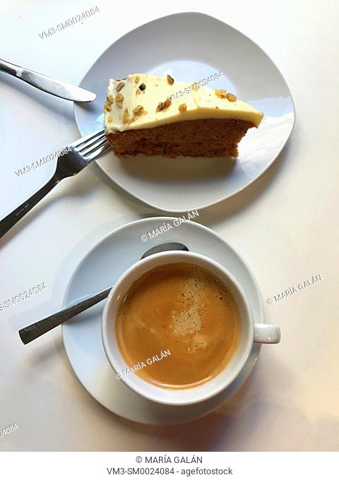 Cup of coffee and piece of carrot cake. View from above
