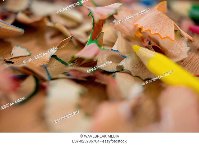 Colored pencil shavings with yellow pencil color