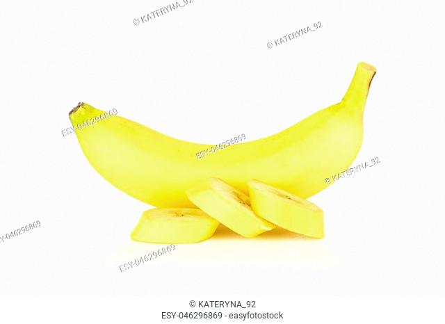 Group of one whole three slices of fresh yellow banana isolated on white background