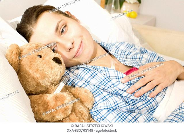Sick woman laying in bed