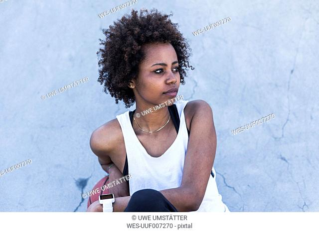 Young woman outdoors looking sideways