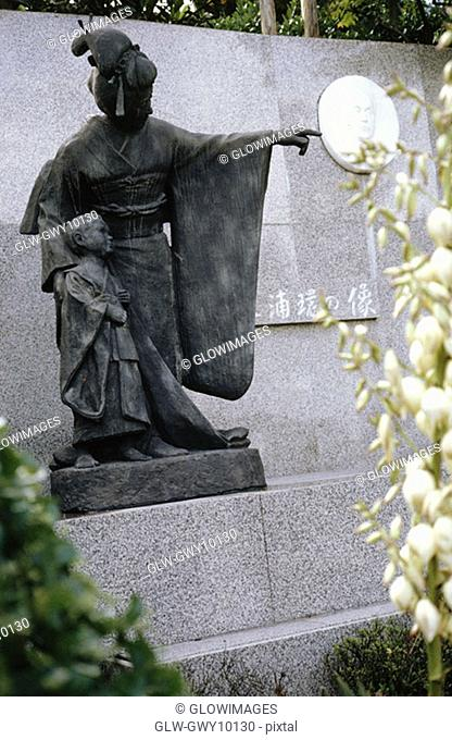 Statue in a garden, Madam Butterfly Statue, Nagasaki, Japan