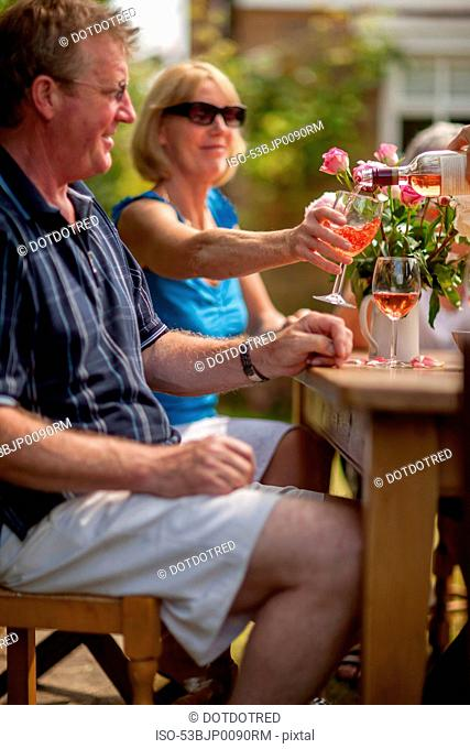 Couple having wine together outdoors