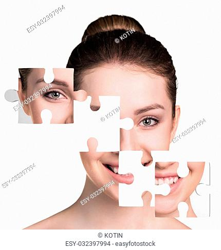 Face of beautiful young woman with a puzzle collage of her skin, isolated on a white background
