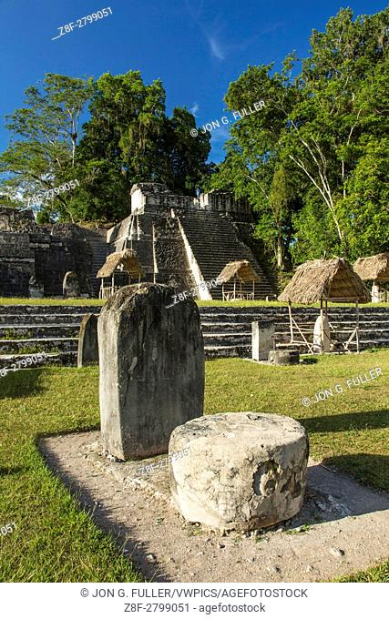 Stela and altar in the Great Plaza in front of the North Acropolis. Tikal National Park, Guatemala, is an archeological site of the pre-Columbian Maya...