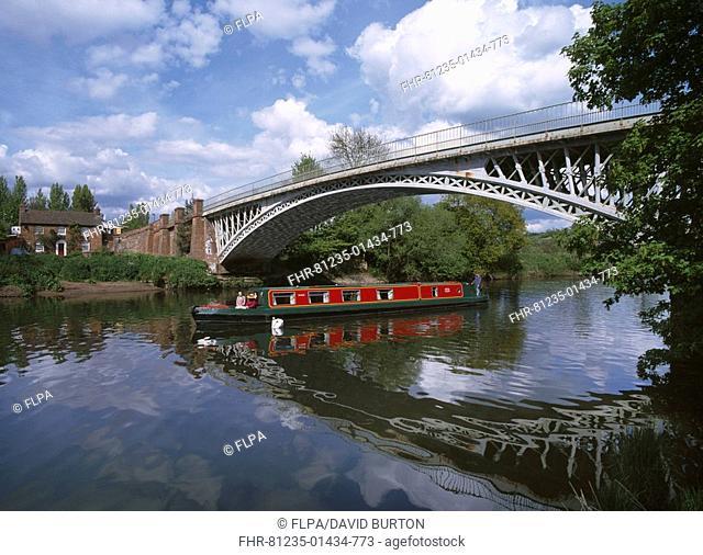 Narrowboat cruising underneath bridge, River Severn, England
