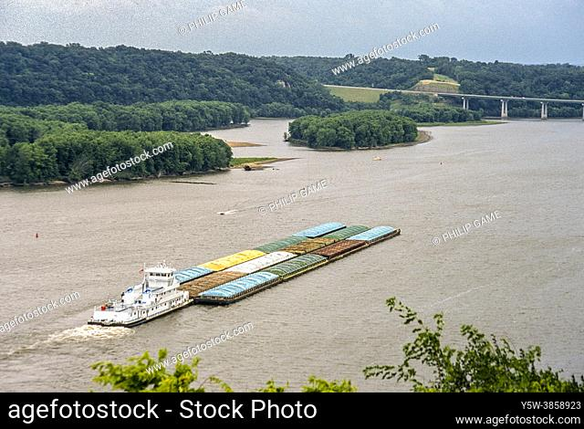 Freight barge on the Mississippi River at Dubuque, Iowa, U. S. A