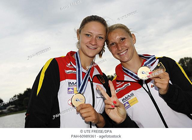 Sabrina Hering (R)and Steffi Kriegerstein of Germany pose with their medals after winning bronze in the women's kayak double 200 m event during the ICF Canoe...