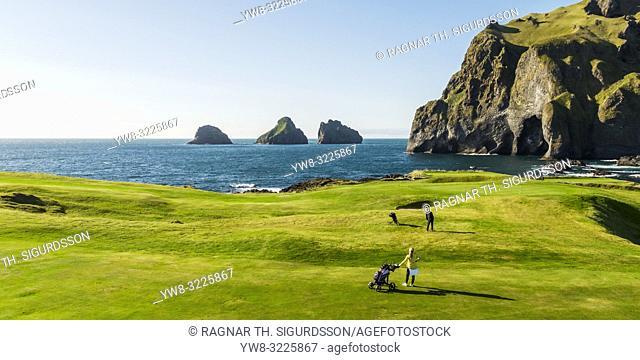 People playing Golf. Vestmannaeyjar Golf Course, Heimaey, Westman Islands, Iceland
