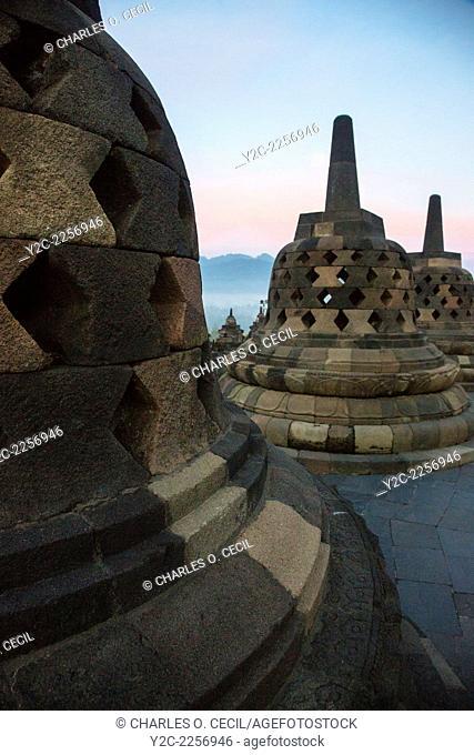 Borobudur, Java, Indonesia. Stupas and Full Moon just before Sunrise