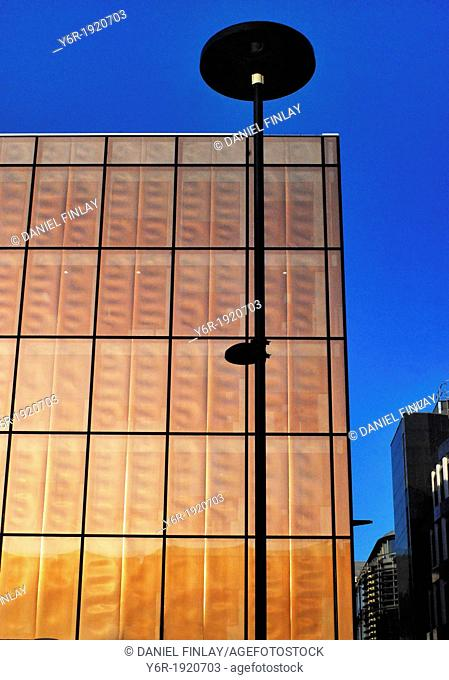 View of avant garde City of London office building seen from Queen Victoria Street, on a very sunny Winter day in southern England