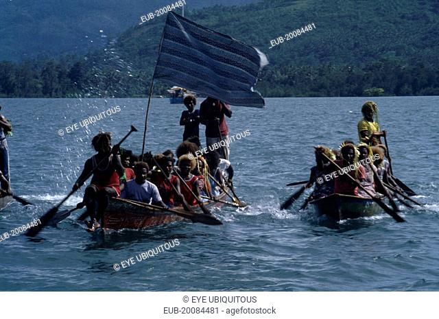 Malaita Province, Lau Lagoon. Wedding party arriving by canoe